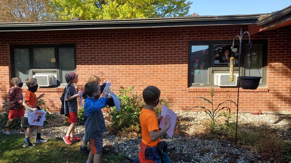 First graders walked by the nursing home