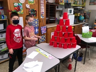Students were building a tree with cans