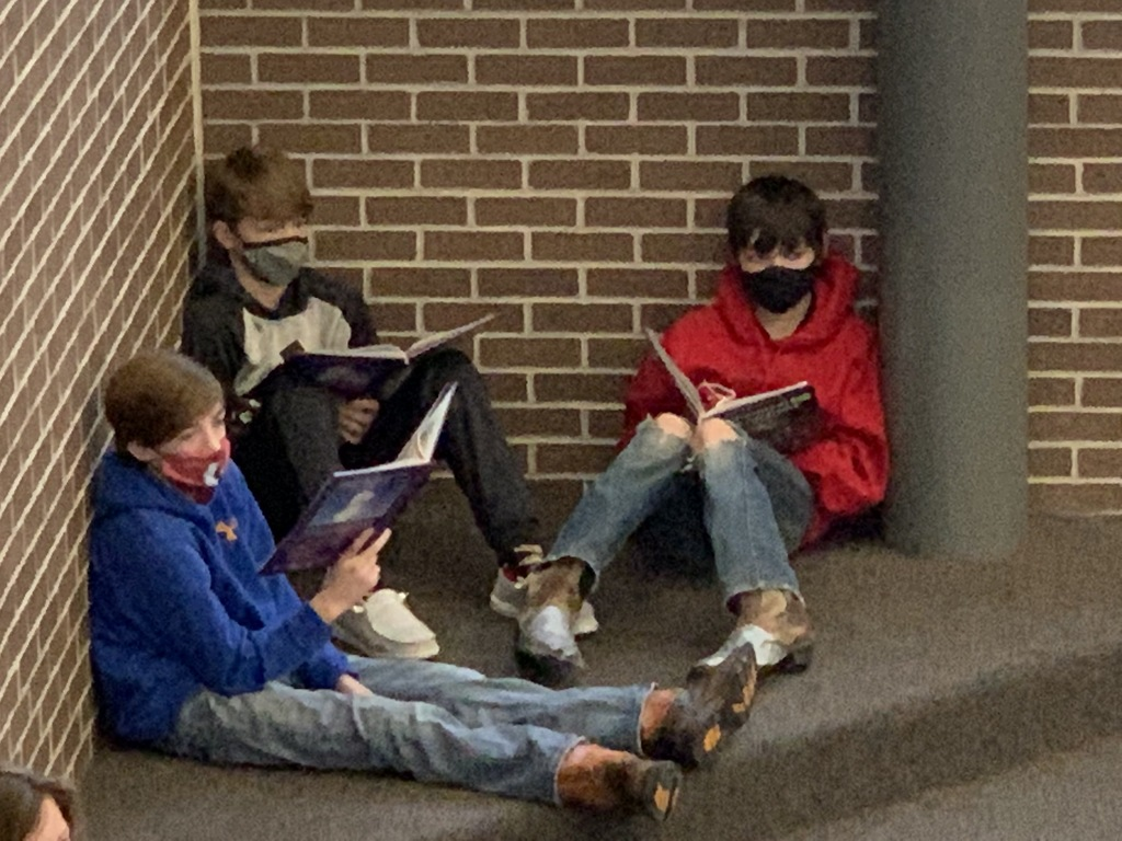 Using the commons space to get out of the classroom, Missy Sinnwell's 6th grader reading a chapter from their science book.