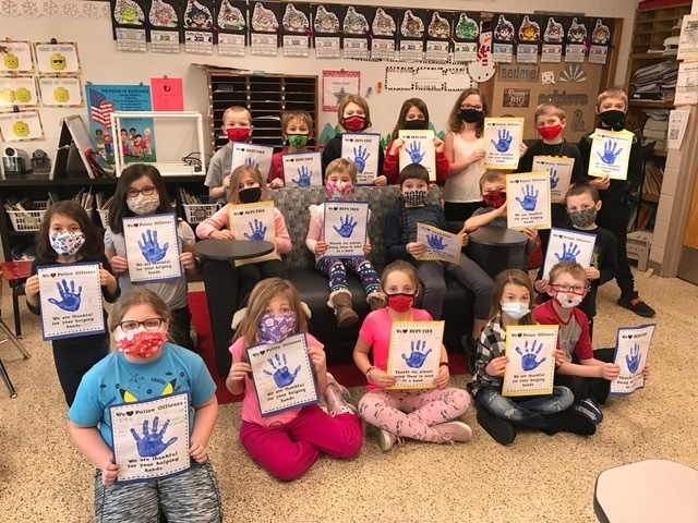Our second grade class read Officer Buckle and Gloria last week in our Journeys book. We decided to make thank you notes for our local police officers and deputies. Here is our class showing off their work.