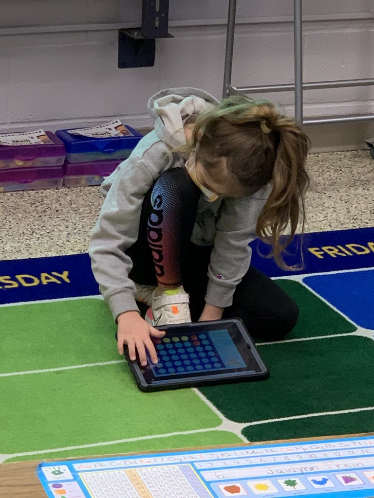 1st graders, in Morgan Kuennen's class, settle in for a morning of learning as they scan a bar code to unlock their academic game on the iPad.