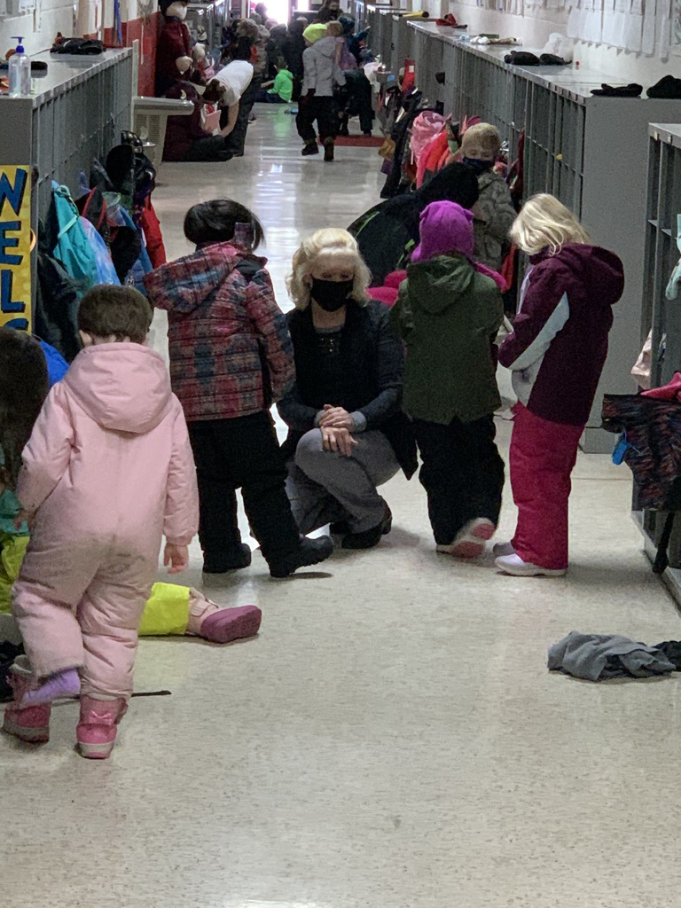 If you want to play with someone, just ask. You have to try (zipping your coat) then I will help you. Mrs. Ollendieck prepares her students to head outside for recess .