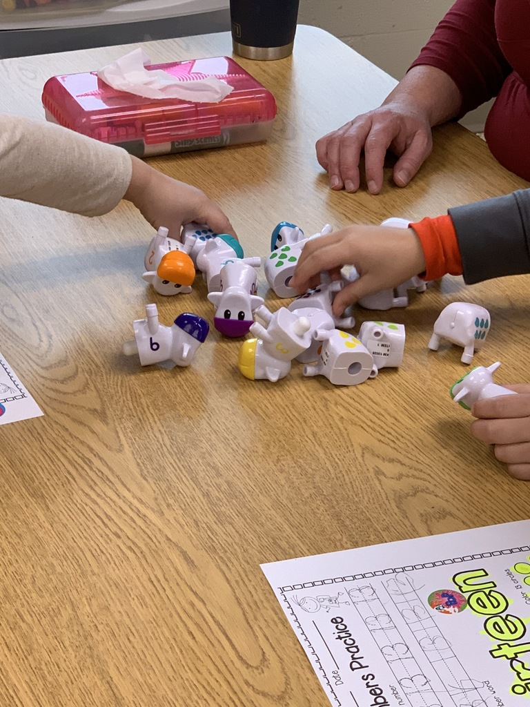 Mrs. Matthews assists her students in learning lots of skills surrounding the lucky number 13!  Students worked on holding a pencil, writing the number, counting and coloring (with smelly markers...yeah).  Manipulatives help solidify the learning.