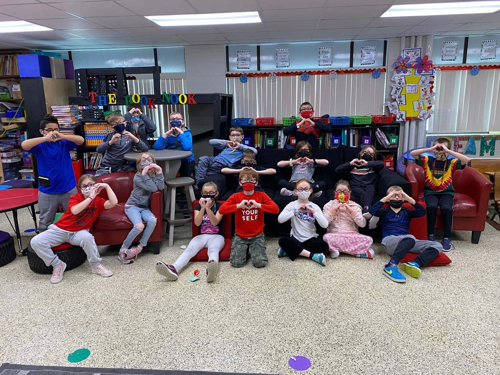 Mrs. Baltes's class celebrated Valentine's day on February 12th. Notice they are sending you love with their heart-shaped hands!