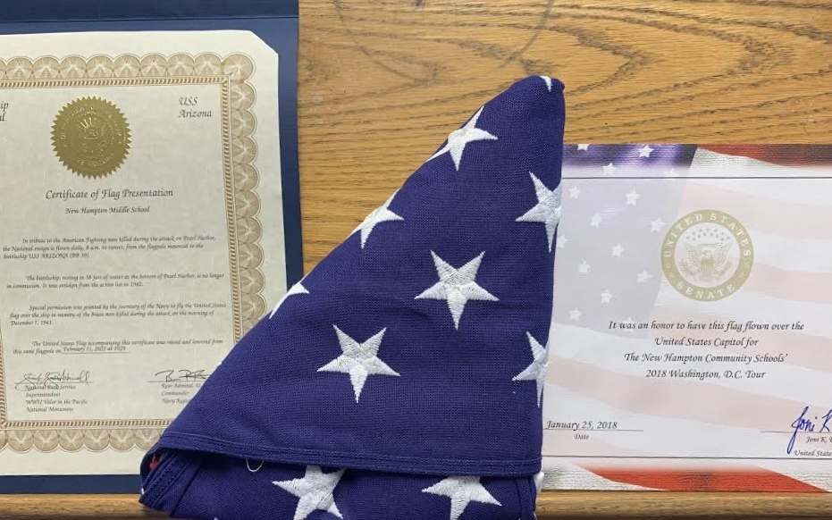 Progress on the Middle School U.S.S. Arizona and Pearl Harbor display is moving along. Today Mr. Rude received back the flag that will be displayed in the case with the relics. It's pretty special. It's been flown over BOTH the U.S. Capitol and the U.S.S. Arizona Memorial.