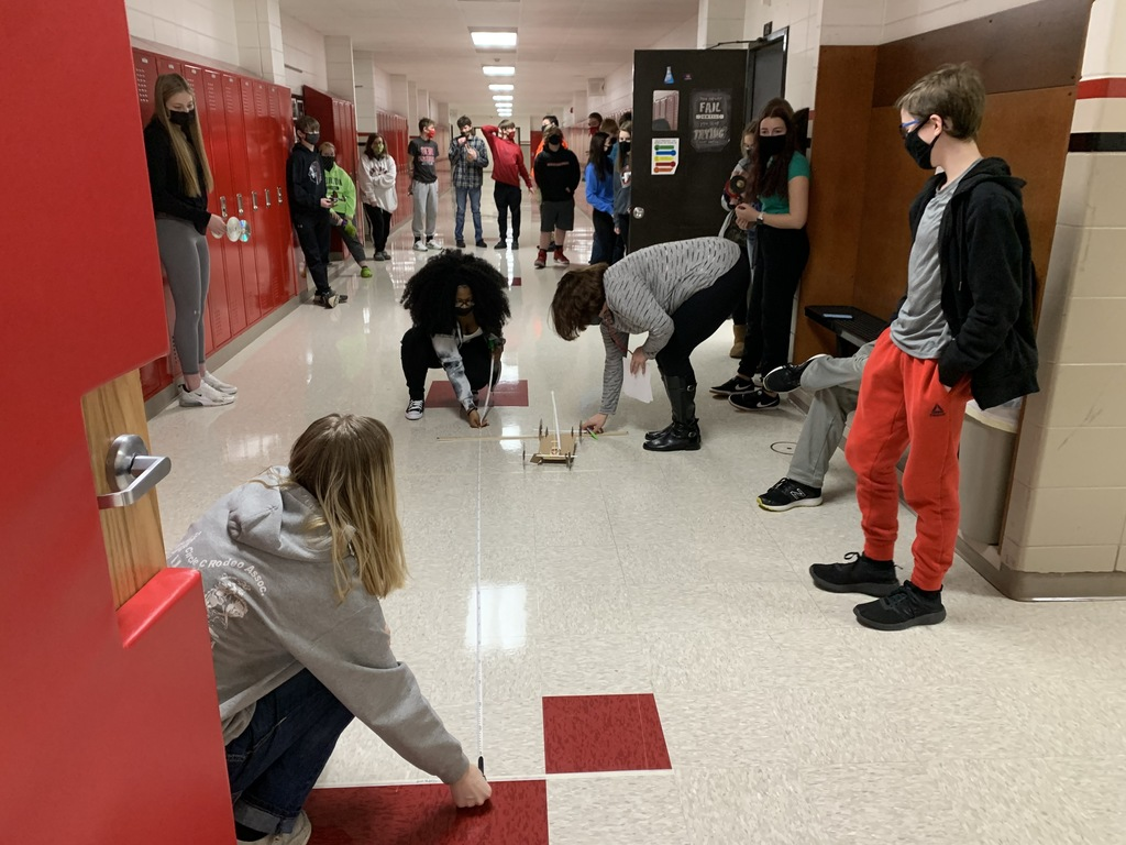 "Round 1 is done.  Return to your garages and make adjustments to improve your distance.""  Freshman with Mrs. Leistikow test out their mousetrap cars."