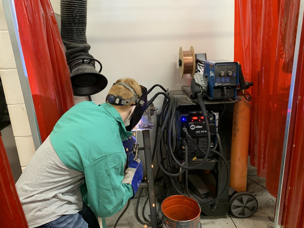 Working on their stick welding joints, student welders light up their booths. NICC instructor (Ron) and NHHS instructor (Ashley Mattke) collaborate to bring welding skills to high school students #NHtribe