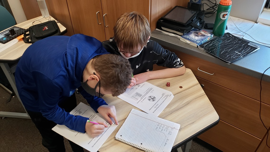 7th grade students conducting experiments to solve compound probability problems in Mr. Erlandson's math class.