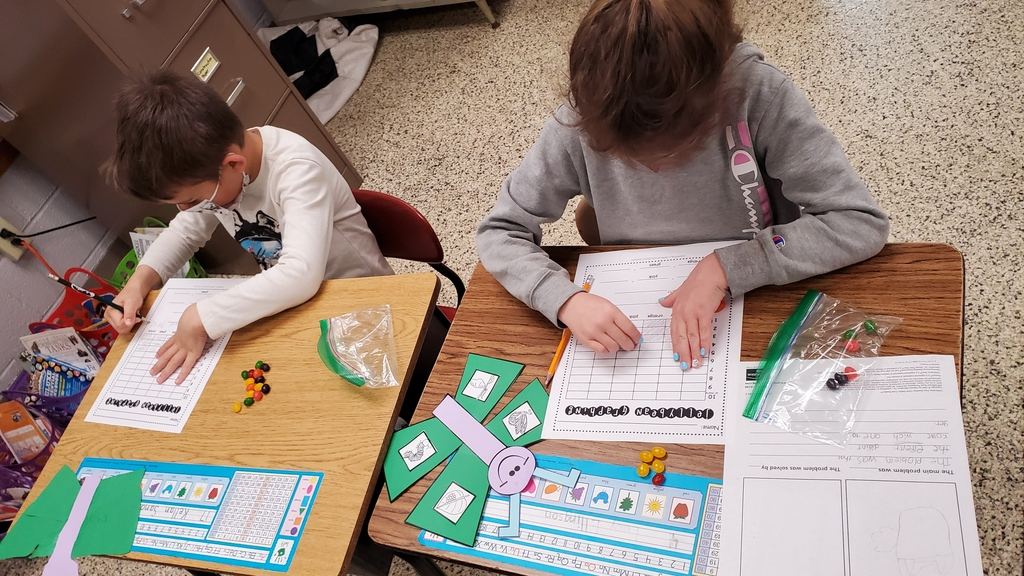 First grade is learning how to graph objects and information using bar graphs, picture graphs, and more! Today they practiced with a fun treat - jelly beans!